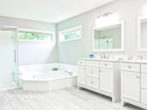 bathroom with tub and vanity